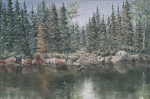 "Rocks Along the Lake Shore is a 12""x18"" original oil painting on canvas of a lake shore lake in the boundary waters wilderness area with fir, spruce, and birch trees and rocks reflected in the water."