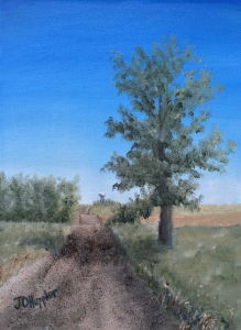 """Road to Town is a 12""""x9"""" original oil painting on canvas of a gravel road in farm country with a small rural town with a water tower in the distance."""