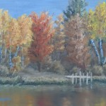 Red Oak Reflection is an 8 inch by 10 inch original oil painting on canvas of trees with vibrant autumn foliage along a quiet lakeshore.