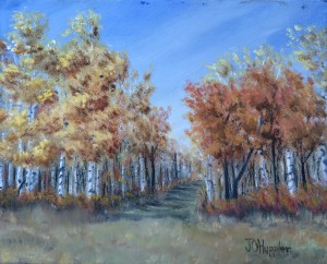 Autumn Woods 4 is an 8 inch by 10 inch original oil painting on canvas of brilliant foliage along a trail in an autumn woods.