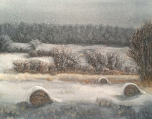 Hay Bales in Snow is a 16 inch by 20 inch original oil painting on canvas of three large round hay bales on a snowy day.