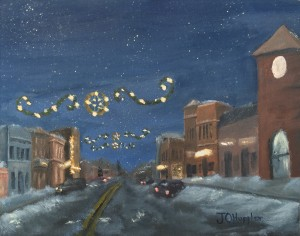 Foley Christmas Lights is an 8 inch by 10 inch original oil painting on canvas of Holiday lights above Main Street of Foley in the evening.
